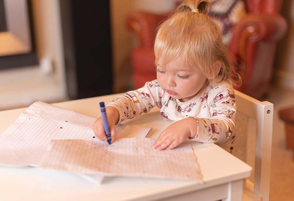 16-month-old baby scribbling on a piece of paper