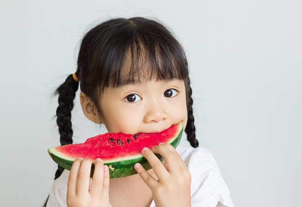 A girl eating a watermelon