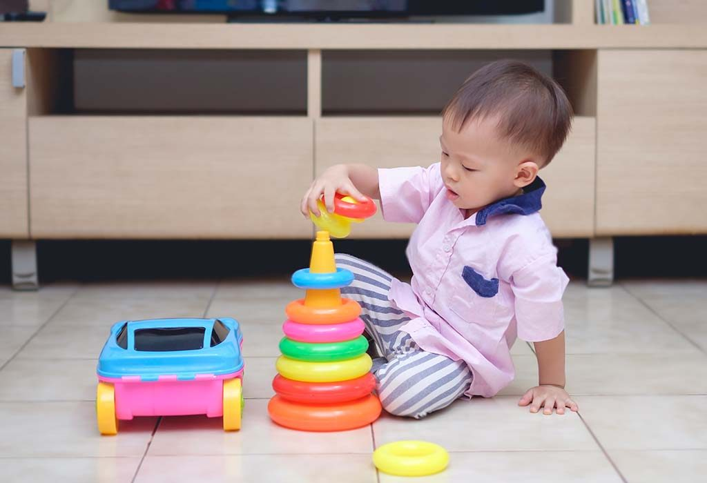 play ring stack toys with your baby to enhance her dexterity skills